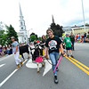 KRISTOPHER RADDER - BRATTLEBORO REFORMER<br /> Jenifer Ortega, from Greenfield, Mass., holds a lightsaber while walking with her heifer during the annual Strolling of the Heifers Parade, in Brattleboro, on Saturday, June 2, 2018.