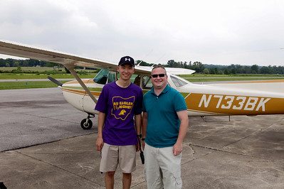 PHOTO PROVIDED / COURTESY WADSWORTH MUNICIPAL AIRPORT Yung Hsu Chien, left, and Tim Lanigan, right, stand in front of a Cessna 172 on Friday, June 3, when Jordan completed his first solo flight.