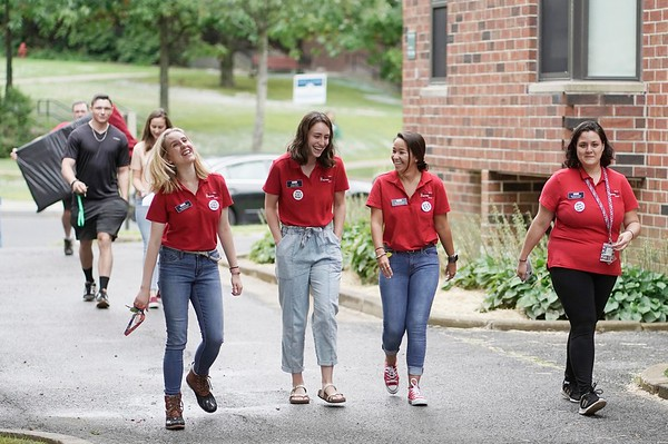 BEN GARVER — THE BERKSHIRE EAGLE<br /> A group of RAs (resident advisors) share a laugh before helping people adjust to life in the Townhouses at the Massachusetts College of Liberal Arts in North Adams, Monday, September 2, 2019.