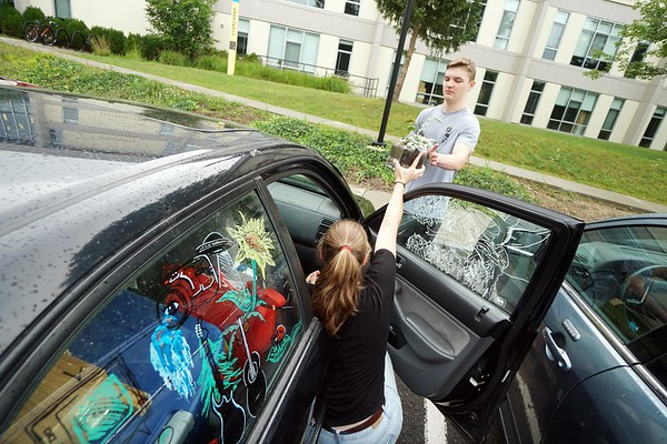 BEN GARVER — THE BERKSHIRE EAGLE<br /> Megan Walsh, a sophomore from Fitchburg, grabs her plants first with the help of Mitchell Kevaney as she moves into her room in the Townhouses at the Massachusetts College of Liberal Arts in North Adams, Monday, September 2, 2019.