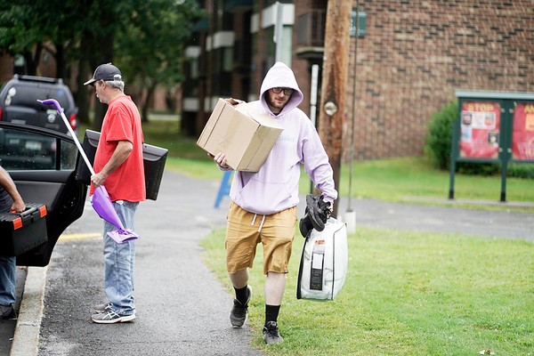 BEN GARVER — THE BERKSHIRE EAGLE<br /> Senior Devin DeLuca  moves into his room in the Townhouses at the Massachusetts College of Liberal Arts in North Adams, Monday, September 2, 2019.