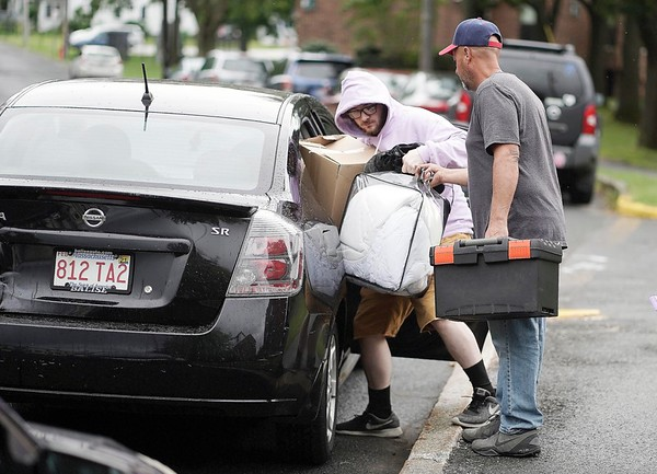 BEN GARVER — THE BERKSHIRE EAGLE<br /> Senior Devin DeLuca and his father Joe DeLuca haul items from the car as he moves into his room in the Townhouses at the Massachusetts College of Liberal Arts in North Adams, Monday, September 2, 2019.