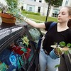 BEN GARVER — THE BERKSHIRE EAGLE<br /> Megan Walsh, a sophomore from Fitchburg, grabs her plants first as she moves into her room in the Townhouses at the Massachusetts College of Liberal Arts in North Adams, Monday, September 2, 2019.