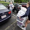 BEN GARVER — THE BERKSHIRE EAGLE<br /> Halle Peers, a sophomore, unpacks her car with the help of Reagan Scattergood (right) as she moves into her room in the Townhouses at the Massachusetts College of Liberal Arts in North Adams, Monday, September 2, 2019.
