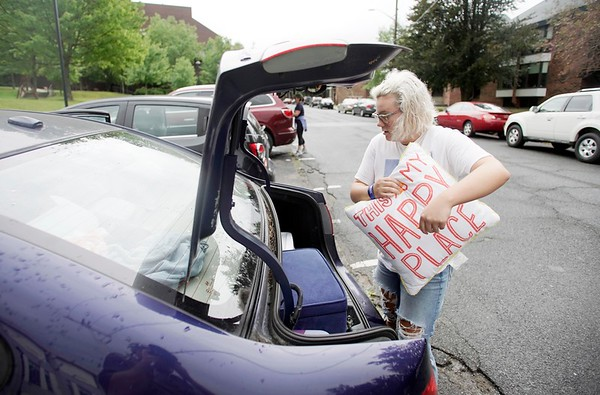 BEN GARVER — THE BERKSHIRE EAGLE<br /> Halle Peers, a sophomore, unpacks her car as she moves into her room in the Townhouses at the Massachusetts College of Liberal Arts in North Adams, Monday, September 2, 2019.