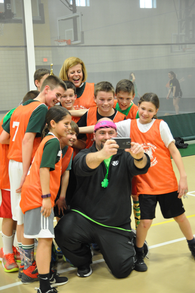 "ASHLEY FOX / GAZETTE Waite Elementary coach Joe Ortenzi takes a ""silly selfie"" with his team and Principal Cindy Grice after winning The Medina County Police Activities League's March Madness championship game."