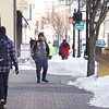 BEN GARVER — THE BERKSHIRE EAGLE<br /> Merchants keep the sidewalks on North Street in Pittsfield clear for pedestrians, Friday, February 1, 2019.
