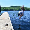 KRISTOPHER RADDER — BRATTLEBORO REFORMER<br /> Savannah Fitzpatrick, 14, from Wardsboro, makes a splash into the water on Tuesday, July 9, 2019.