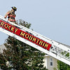 "A firefighter from Rocky Mountain Fire and Rescue comes down the ladder after spray the home with water.<br /> A firefighter was injured and a family displaced in Superior early this morning after a fire broke out in the home at 3929 South Torrey's Peak Drive.<br /> For more photos and a video of the fire, got to  <a href=""http://www.dailycamera.com"">http://www.dailycamera.com</a>.<br /> Cliff Grassmick  / September 23, 2012"