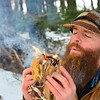 KRISTOPHER RADDER - BRATTLEBORO REFORMER<br /> Nick Neddo, a teacher of wilderness survival, blows into the tinders after placing a coal in it to create fire.