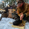 KRISTOPHER RADDER - BRATTLEBORO REFORMER<br /> <br /> Nick Neddo, a teacher of wilderness survival, shows students how to create a fire using a hand drill.