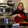 KRISTOPHER RADDER - BRATTLEBORO REFORMER<br /> Dara Levy, the owner of Sweet Miri's Cafe, plates gluten-free snickerdoodle cookies at her new location on 55 Elliot Street, in Brattleboro, on Tuesday, April 3, 2018.