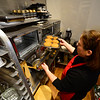 KRISTOPHER RADDER - BRATTLEBORO REFORMER<br /> Dara Levy, the owner of Sweet Miri's Cafe, pulls out a tray of gluten-free snickerdoodle cookies at her new location on 55 Elliot Street, in Brattleboro, on Tuesday, April 3, 2018.