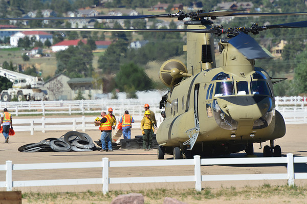 20EP Flood Chanook.jpg Workers unload a National Guard Chanook helicopter at the Stanley Fairgrounds on Friday. The huge helicopters have been used to evacuate people, as well as move supplies around the Front Range during the flood and early recovery efforts.