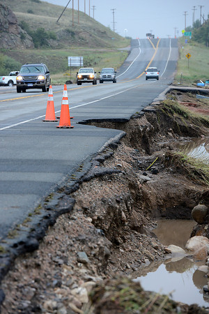 Flood waters washed away part of U.S. 34 east of Glade Road west of Loveland seen here on Sunday, September 15, 2013 west of Loveland. (Photo by Jenny Sparks/Loveland Reporter-Herald)