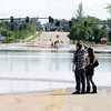 Adam Small and Natalie Weingardt look across Taft Avenue which is flooded north of First Street in Loveland on Friday, September 13, 2013. (Photo by Jenny Sparks/Loveland Reporter-Herald)