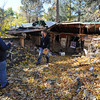 Allen Turner, left, and John Ormsby, Federal Emergency Management Agency employees, walk around a home torn apart by flood waters Wednesday, October 23, 2013, on Hummingbird Lane west of Loveland while assessing flood damage in the area with Larimer County building inspectors. (Photo by Jenny Sparks/Loveland Reporter-Herald)