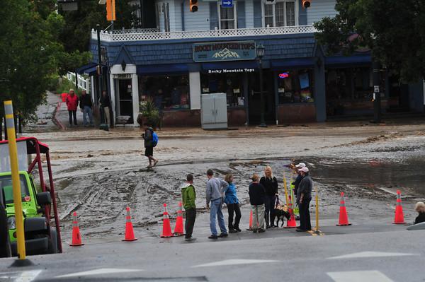 18EP Flood 2 Elkhorn and Moraine.jpg Curious residents check out rain and mud at Elkhorn and Moraine avenues on Friday.