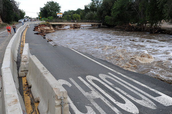 Baricades block of a section of U.S. 34 near the Riverview RV Park west of Loveland Tuesday, September 17, 2013, that was damaged when the Big Thompson River flooded. (Photo by Jenny Sparks/Loveland Reporter-Herald)