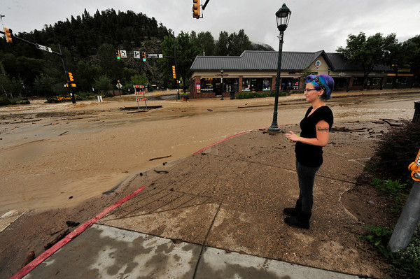 17EP Flood Unbarable Witness.jpg A local has a hard time looking at the destruction on Elkhorn Avenue on Friday. Most of the businesses in the downtown section of Elkhorn Avenue suffered some damage from the historic flood.