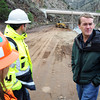 Sen. Michael Bennet, right, checks out the flood damage on U.S. 34 Friday, October 6, 2013 at the mouth of the Big Thompson Canyon west of Loveland as CDOT crews work on the road. (Photo by Jenny Sparks/Loveland Reporter-Herald)