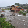 13EP Flood House.jpg A house with people still inside is completely surrounded by the Fish Creek on Thursday. Flooding closed roads and neighborhoods around Estes Park as heavy rain soaked the entire Front Range.