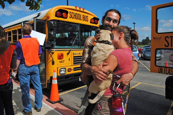 Kalyn Taylor, right, hugs Alexander Diederich and their pug Phoebe after they arrived at Timberline Church in Fort Collins on Monday September 16, 2013. Diederich was one of the evacuees rescued from Drake along with Phoebe his dog. (Photo by Lilia Munoz/Loveland Reporter-herald)