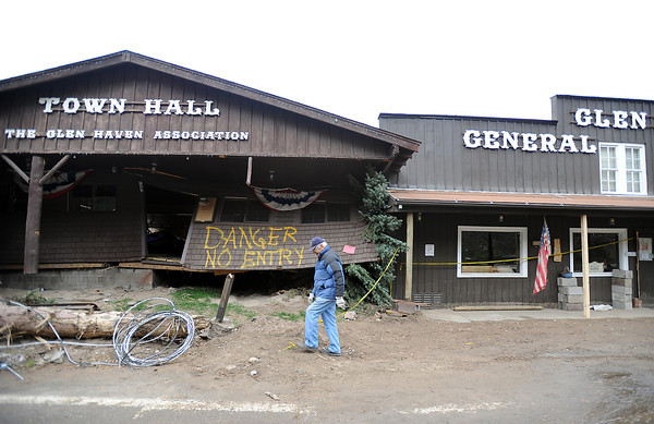 Resident Duke Sumonia walks past the town hall and general store October 14, 2013 in Glen Haven. (Photo by Jenny Sparks/Loveland Reporter-Herald)