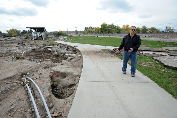 Dan Willadsen, crew supervisor for City of Loveland Parks and Recreation, shows Thursday, October 17, 2013, how the flood waters ate away at the land at Fairgrounds Park in Loveland. (Photo by Jenny Sparks/Loveland Reporter-Herald)