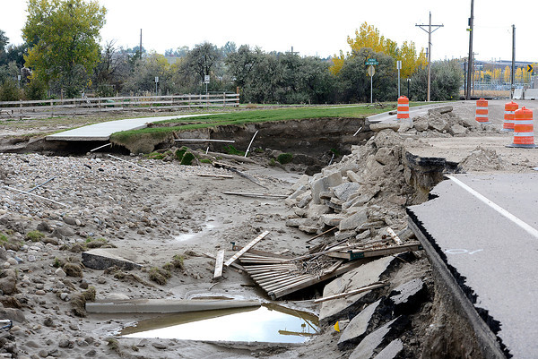 Sidewalks, land and roads were destroyed by the flood, seen here Thursday, October 17, 2013, at Fairgrounds Park in Loveland. (Photo by Jenny Sparks/Loveland Reporter-Herald)