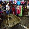 15EP Flood Mud.jpg Friends and volunteers help clear mud from Outdoor World on Saturday. Many businesses along Elkhorn Avenue found mud covering their floors when they got to the stores.