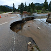 15EP Flood YMCA.jpg A sink hole compomises the road into the YMCA of the Rockies after the historic rain and flash flooding this week. The rains undercut several sections of Spur 66 and breached the dam that held back Dorsey Lake.