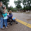 The Bounds family looks at the destruction from flooding at Glade Park on the Big Thompson River west of Loveland on Sunday, September 15, 2013 west of Loveland. (Photo by Jenny Sparks/Loveland Reporter-Herald)