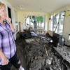 Diana Carnahan stands Monday, September 16, 2013 in her sunroom of her Glade Road home which is now filled with mud from the Big Thompson River flooding. (Photo by Jenny Sparks/Loveland Reporter-Herald)