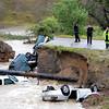Bridge Out Car in Creek from Rain63  Bridge Out Car in Creek fro