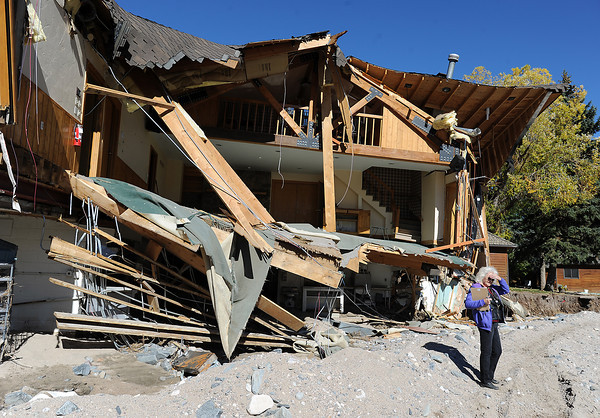Federal Emergency Management Agency employee Peggy Smith assesses flood damage at the Sylvan Dale Guest Ranch Wednesday, October 23, 2013,west of Loveland with a FEMA crew and Larimer County building inspectors. (Photo by Jenny Sparks/Loveland Reporter-Herald)