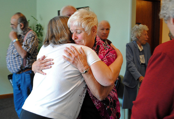 Joyce Kilmer, right, is comforted by Alice Orrison after speaking about her experience during the flood on Sunday September 22, 2013 at the Allnutt Funeral service in Loveland. Members of the Chapel of the Interlude in Drake have moved their services to Allnutt since their Chapel has been left in bad condition after the flood.(Photo by Lilia Munoz/ Loveland Reporter-Herald)
