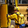 A volunteer fire fighter jumps on a truck to go check for hot spots from the Fourmile fire in Gold Hill, Colorado September 9, 2010.  Over 100 homes and structures have been destroyed since Monday. CAMERA/Mark Leffingwell (POOL)