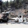 Destroyed vehicles from the Fourmile Canyon fire in Boulder, Colorado September 9, 2010.  CAMERA/Mark Leffingwell (POOL)