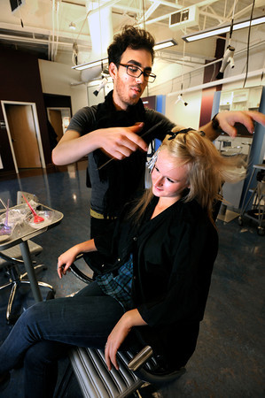 "Stylist Tyler Sopris, applies color to Emilie Druss' hair in the Zinke Knoebel Hair Studio at the Twenty Ninth Street Mall in Boulder Colorado on Wednesday.<br /> For more photos from the mall go to  <a href=""http://www.dailycamera.com"">http://www.dailycamera.com</a>.<br /> Photo by Paul Aiken / October 12, 2001"