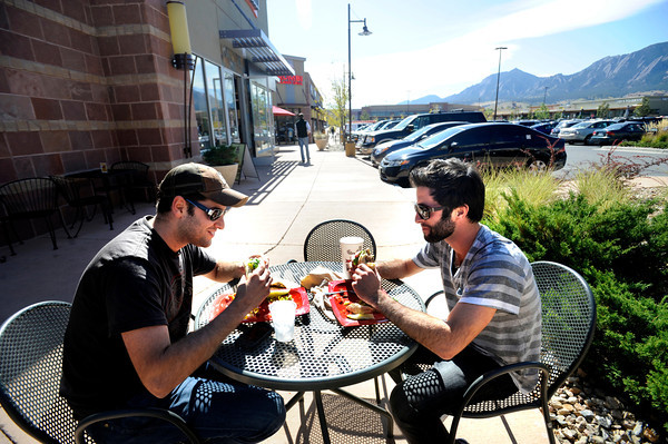 """Dan Konigsberg, left and coworker Paul Berliner enjoy lunch on the pation of the Smiling Moose Deli at the Twenty Ninth Street Mall in Boulder Colorado on Wednesday.<br /> For more photos from the mall go to  <a href=""""http://www.dailycamera.com"""">http://www.dailycamera.com</a>.<br /> Photo by Paul Aiken / October 12, 2001"""