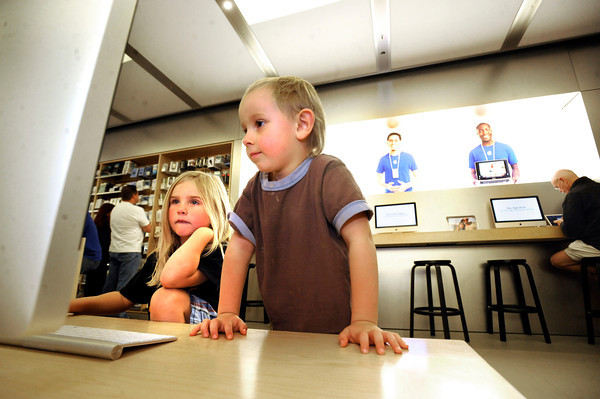 """River Roberts, 5, at left, and Piyo Dedrick-Fodeman, 4, look on to a large computer in the Apple store at the Twenty Ninth Street Mall in Boulder Colorado on Wednesday.<br /> For more photos from the mall go to  <a href=""""http://www.dailycamera.com"""">http://www.dailycamera.com</a>.<br /> Photo by Paul Aiken / October 12, 2001"""