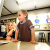 "River Roberts, 5, at left, and Piyo Dedrick-Fodeman, 4, look on to a large computer in the Apple store at the Twenty Ninth Street Mall in Boulder Colorado on Wednesday.<br /> For more photos from the mall go to  <a href=""http://www.dailycamera.com"">http://www.dailycamera.com</a>.<br /> Photo by Paul Aiken / October 12, 2001"