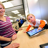 "Stephanie Darcy gets a laugh out of her daughter Riley's Ipad artwork as they shop at the Apple store in the Twenty Ninth Street Mall in Boulder Colorado on Wednesday. Riley is 18 months old. <br /> For more photos from the mall go to  <a href=""http://www.dailycamera.com"">http://www.dailycamera.com</a>.<br /> Photo by Paul Aiken / October 12, 2001"