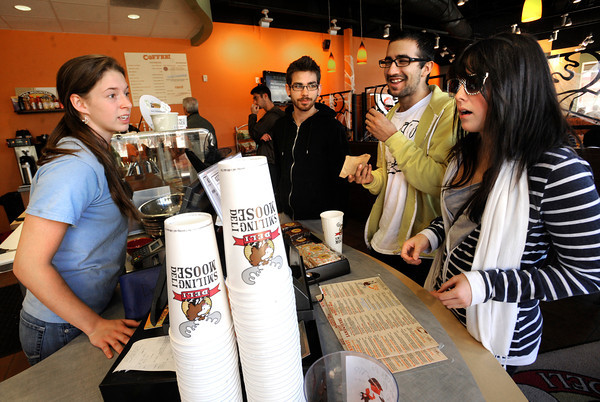 Smiling Moose shift supervisor Danielle Walker takes a lunch order from Chelsea Donaldson, right as friends David Ruhter, center left adn Amir Mirfakhrai look on at the Twenty Ninth Street Mall in Boulder Colorado on Wednesday.<br /> Photo by Paul Aiken / October 12, 2001
