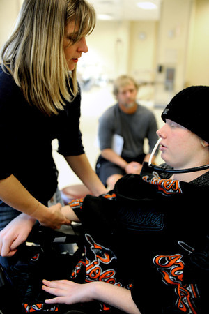 20111212-TylerHoog15.jpg.jpg Darci Pernoud, left, has Tyler Hoog try and flex his muscles while she holds his arm during an occupational therapy session at the Shepherd Spinal Center in Atlanta, GA on Monday, December 12, 2011. Hoog has been paralyzed from the neck down since August when he was injured in a four wheeling accident.   (Jonathan Phillips Special to the Boulder Daily Camera)