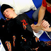 20111212-TylerHoog24.jpg.jpg Tyler Hoog lays on a mat as Kelly White, an exercise specialist at the Shepherd Spinal Center in Atlanta, GA, stretches his arms and legs during a therapy session on Monday, December 12, 2011. The Skyline baseball player became paralyzed after a four wheeling accident in August.  (Jonathan Phillips Special to the Boulder Daily Camera)