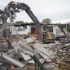 BEN GARVER — THE BERKSHIRE EAGLE<br /> Crews works to demolish the old Taconic High School building. Parts of the gym are visible and the academic wings are still standing at this point.