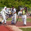 BEN GARVER — THE BERKSHIRE EAGLE<br /> Bret Rector from Copeland Coatings out of Nassau, N.Y. uses a custom made sprayer to resurface the long jump area at Taconic High School, Friday, June 7, 2019. The polyurethane coating has bits of rubber mixed in and is the same color as the track's original coating.