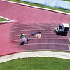 BEN GARVER — THE BERKSHIRE EAGLE<br /> Workers from Copeland Coatings out of Nassau, N.Y. resurface the track at Taconic High School, Friday, June 7, 2019. The polyurethane coating has bits of rubber mixed in and is the same color as the track's original coating.